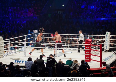 KYIV, UKRAINE - DECEMBER 13, 2014: Oleksandr Usyk of Ukraine (white-black shorts) and Danie Venter of South Africa in the ring during WBO Intercontinental Cruiserweight Title fight - stock photo