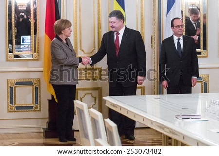 KYIV, UKRAINE - Feb 5, 2015: French President Francois Hollande and Chancellor of the Federal Republic of Germany Angela Merkel during an official meeting with President of Ukraine Petro Poroshenko   - stock photo