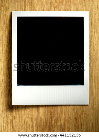 KYIV, UKRAINE - FEB 13, 2014: Polaroid photo cards on wooden background.  - stock photo