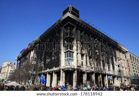KYIV, UKRAINE - FEBRUARY 21, 2014: Trade Union building, which had been used as an opposition base at Maidan Nezalezhnosti (Independence Square) aftermath the fire during anti-government protests - stock photo