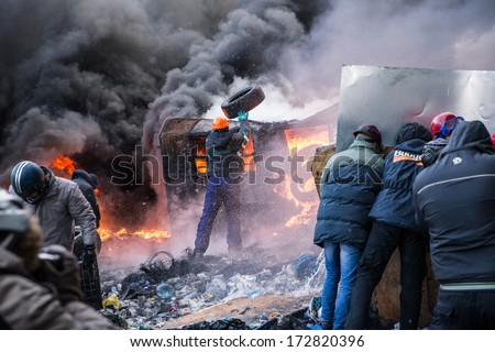 KYIV, UKRAINE - JAN 23: Angry crowd on the occupying street on the demostration during anti-government protest Euromaidan on January 23, 2014, in center of Kiev, Ukraine