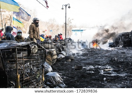 KYIV, UKRAINE - JAN 23: Angry crowd on the occupying street on the demostration during anti-government protest Euromaidan on January 23, 2014, in center of Kiev, Ukraine - stock photo