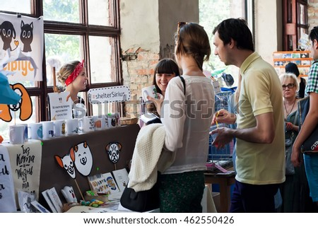 KYIV, UKRAINE - JUL 23: People choose and buy products for animals and for the house on the market on July 23, 2016. Kiev is the 8th most populous city in Europe.