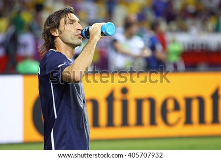KYIV, UKRAINE - JULY 1, 2012: Andrea Pirlo of Italy drinks water during warm-up session before UEFA EURO 2012 Final game against Spain at Olympic stadium in Kyiv, Ukraine - stock photo