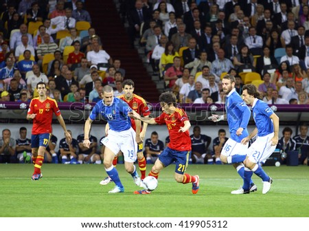 KYIV, UKRAINE - JULY 1, 2012: David Silva of Spain (in Red, #21) attacks during UEFA EURO 2012 Final game against Italy at Olympic stadium in Kyiv, Ukraine - stock photo