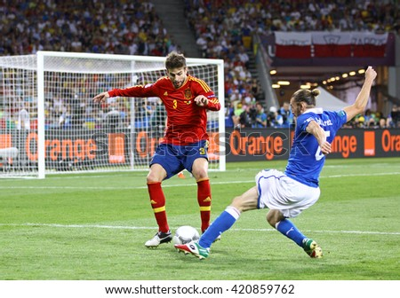 KYIV, UKRAINE - JULY 1, 2012: Gerard Pique of Spain (L) fights for a ball with Federico Balzaretti of Italy during their UEFA EURO 2012 Final game at Olympic stadium in Kyiv, Ukraine - stock photo