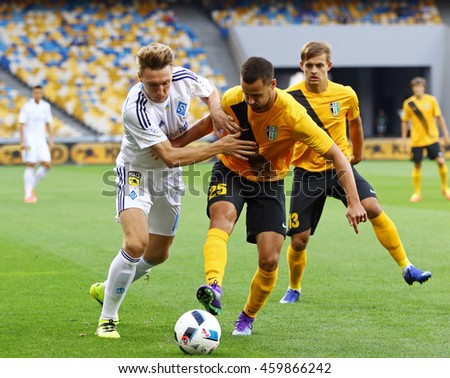 KYIV, UKRAINE - JULY 23, 2016: Serhiy Sydorchuk of Dynamo Kyiv (L) fights for a ball with Sergiy Chebotayev of FC Oleksandria during their Ukrainian Premier League game at NSC Olympic stadium in Kyiv