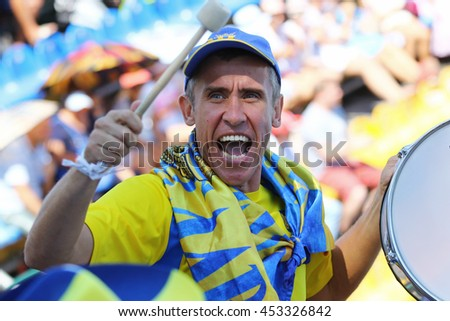 KYIV, UKRAINE - JULY 15, 2016: Ukrainian supporters show their support during BNP Paribas Davis Cup Europe/Africa Zone Group I game Ukraine v Austria at Campa Bucha Tennis Club in Kyiv, Ukraine - stock photo