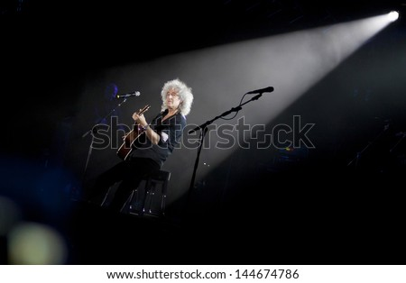 KYIV, UKRAINE - JUNE 30: Brian May of Queen performs onstage during charity Anti-AIDS concert at the Independence Square on June 30, 2012 in Kyiv, Ukraine - stock photo