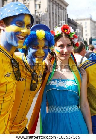 KYIV, UKRAINE - JUNE 19 2012: Official fan zone on Khreshatyk street. Sweden football fans before start match Sweden France, Group D.  EURO 2012 in Kyiv, 19 june 2012 - stock photo