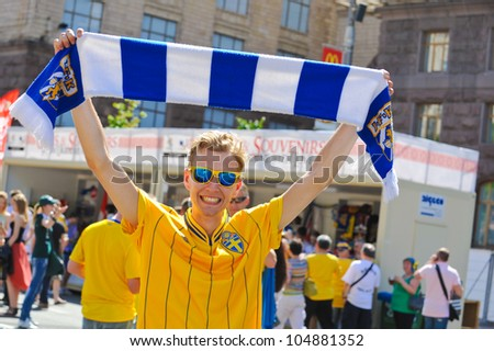 KYIV, UKRAINE - JUNE 11: Sweden and Ukrainian fans arrive in the fanzone before match Euro 2012 between Ukraine - Sweden on June 11, 2012 in Kyiv, Ukraine. Zone for the fans UEFA EURO Championship. - stock photo