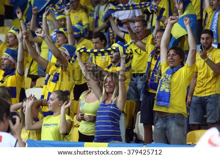 KYIV, UKRAINE - JUNE 11, 2012: Swedish football supporters show their support during UEFA EURO 2012 game against Ukraine at Olympic stadium in Kyiv