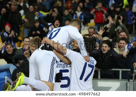 KYIV, UKRAINE - MARCH 19, 2015: Dynamo Kyiv fans celebrating scored goal with players, UEFA Europa League Round of 16 second leg match between Dynamo and Everton