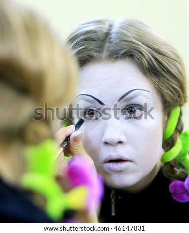 "KYIV, UKRAINE - MARCH 11: mime puts his makeup on getting ready for his show called ""Marcel Marceau's Successors"" backstage at the Actor's House on March 11, 2008 in Kyiv, Ukraine"