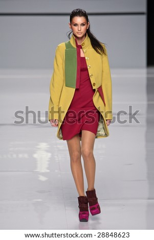"KYIV, UKRAINE - March 13, 2009: Model walks the runway during Fashion Show by ""Anna Bublik Exclusive collection"" as part of Ukrainian Fashion Week, March 13, 2009 in Kyiv, Ukraine."