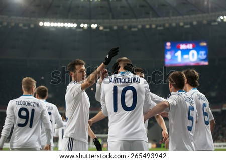 KYIV, UKRAINE - MARCH 19, 2015: Players of Dynamo Kyiv celebrating the scored goal during their UEFA Europe League game with Everton at NSC Olimpiyskiy stadium on March 19, 2015 in Kyiv, Ukraine. - stock photo
