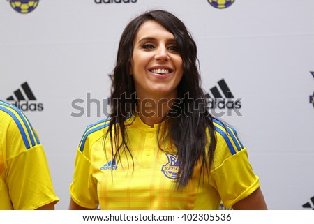KYIV, UKRAINE - MARCH 9, 2016: Singer Jamala (who will represent Ukraine in Eurovision Song Contest 2016) poses during presentation of the New jerseys of the National Football Team of Ukraine - stock photo