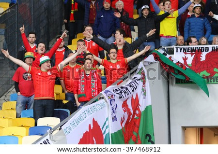 KYIV, UKRAINE - MARCH 28, 2016: Welsh supporters show their support during Friendly match between Ukraine and Wales at NSC Olympic stadium in Kyiv, Ukraine - stock photo