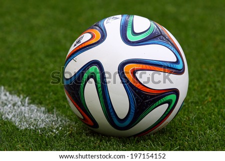 KYIV, UKRAINE - MAY 18, 2014: Close-up official FIFA 2014 World Cup ball (Brazuca) on the grass during Ukraine Championship game between FC Dynamo Kyiv and FC Zorya Luhansk at Olympic stadium in Kyiv - stock photo
