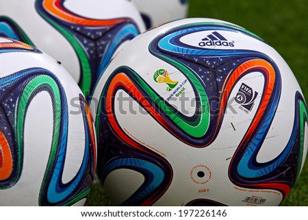 KYIV, UKRAINE - MAY 18, 2014: Close-up official FIFA 2014 World Cup balls (Brazuca) on the grass during Ukraine Championship game between FC Dynamo Kyiv and FC Zorya Luhansk at Olympic stadium in Kyiv - stock photo