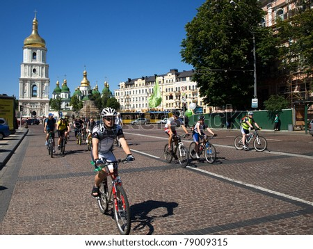 KYIV, UKRAINE - MAY 28: Cyclists travel down Sophia Square during annual Ukrainian Bike Day rally to protect their rights on May 28, 2011 in Kyiv, Ukraine