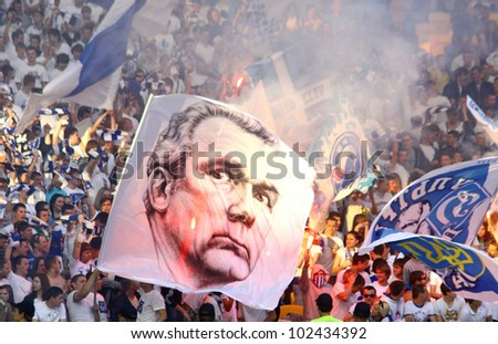 KYIV, UKRAINE - MAY 10: FC Dynamo Kyiv team supporters show their support with big portrait of famous Valeriy Lobanovskyi during Ukraine Championship game against FC Tavriya on May 10, 2012 in Kyiv