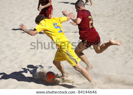 KYIV, UKRAINE - MAY 28: Igor BORSUK of Ukraine (L) fights for a ball with Yury GORCHINSKIY of Russia during their friendly beach soccer game on May 28, 2011 in Kyiv, Ukraine