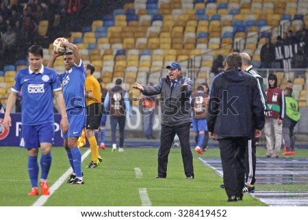 KYIV, UKRAINE - MAY 14, 2015: Rafael Benitez, head coach of SSC Napoli (in Center) reacts during the UEFA Europa League semifinal game against FC Dnipro at NSK Olimpiyskyi stadium - stock photo