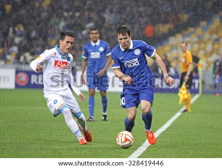 KYIV, UKRAINE - MAY 14, 2015: Yevhen Konoplyanka of FC Dnipro (R) fights for a ball with Jose Callejon of SSC Napoli during their UEFA Europa League semifinal game at NSK Olimpiyskyi stadium - stock photo