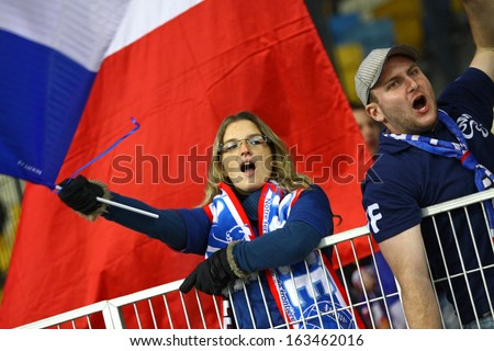 KYIV, UKRAINE - NOVEMBER 15: France national football team supporters show their support during FIFA World Cup 2014 qualifier game against Ukraine on November 15, 2013 in Kyiv, Ukraine - stock photo