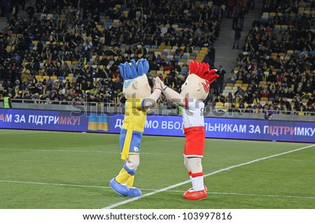 KYIV, UKRAINE - NOVEMBER 11: Slavek and Slavko, the UEFA Euro 2012 mascots playing during friendly game between Ukraine and Germany at NSK Olimpic stadium on November 11, 2011 in Kyiv, Ukraine - stock photo