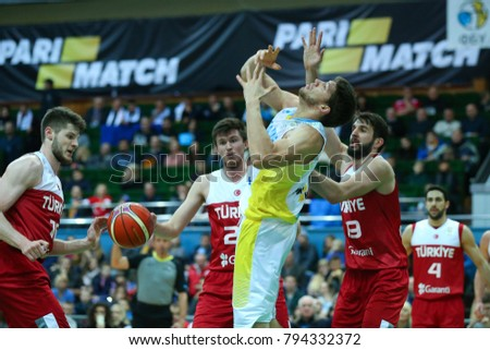 KYIV, UKRAINE - NOVEMBER 26, 2017: Viacheslav KRAVTSOV. Ukrainian center been fouled under pressure of defenders. FIBA European Qualifiers World Cup 2019 Ukraine - Turkey