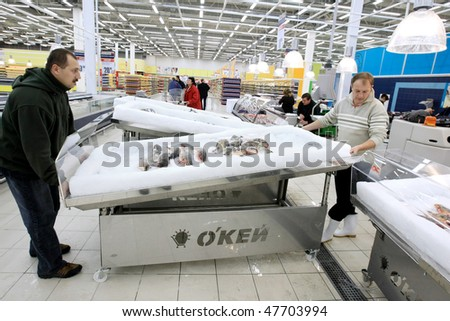 KYIV, UKRAINE - NOVEMBER 13: Workers prepare for the grand opening of OK supermarket network on November 13, 2007 in Kyiv, Ukraine. - stock photo