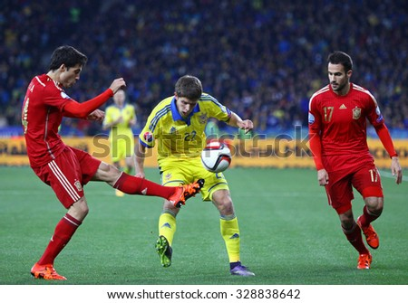 KYIV, UKRAINE - OCTOBER 12, 2015: Artem Kravets of Ukraine (C) fights for a ball with Xabier Etxeita (L) and Mario Gaspar (R) of Spain during their UEFA EURO 2016 Qualifying game - stock photo