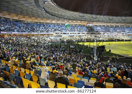 KYIV, UKRAINE - OCTOBER 8: Audience waiting for official opening of main Euro-2012 stadium - Olympic stadium (NSC Olimpiysky) on October 8, 2011 in Kyiv, Ukraine - stock photo