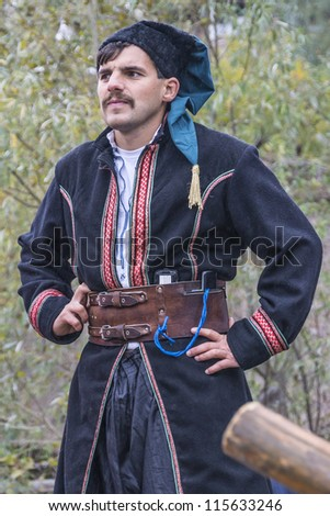 "KYIV, UKRAINE - OCTOBER 14: Celebration of the Ukrainian Cossacks Day in museum Cossack village ""Mamajeva Sloboda"", at October 14, 2012 in Kyiv, Ukraine. Traditional clothes of Cossack."