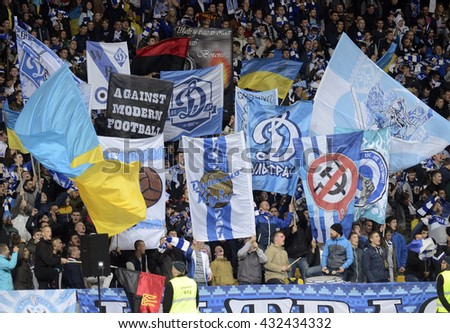 KYIV, UKRAINE - OCTOBER 2, 2014:Dynamo fans cheering for their favorites during the UEFA Europa League game between Dynamo Kyiv and Steaua Bucharest on Olimpiyskiy Stadium. - stock photo