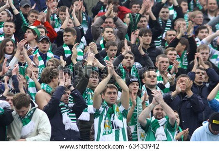 KYIV, UKRAINE - OCTOBER 16: FC Karpaty Lviv team supporters show their support during Ukraine Championship game against FC Dynamo Kiev on October 16, 2010 in Kyiv, Ukraine - stock photo