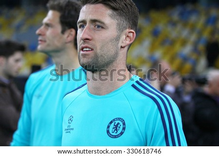 KYIV, UKRAINE - OCTOBER 19, 2015: Gary Cahill of FC Chelsea walks on during training session at NSC Olimpiyskyi stadium before UEFA Champions League game against FC Dynamo Kyiv - stock photo