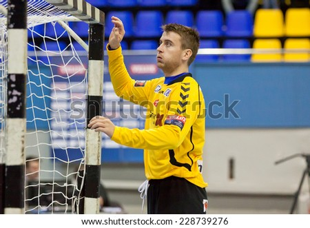 KYIV, UKRAINE - OCTOBER 18, 2014: Goalkeeper Ole Erevik of Aalborg in action during European Handball Champions League game against Motor - stock photo