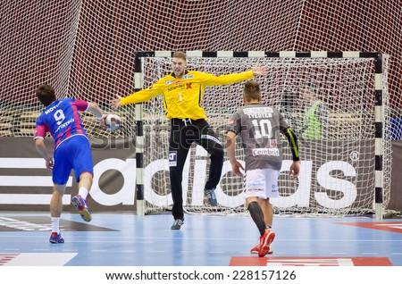 KYIV, UKRAINE - OCTOBER 18, 2014: Oleg Skopintsev of Motor (#9) throws the penalty kick during European Handball Champions League game against Aalborg - stock photo