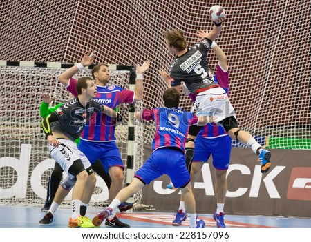 KYIV, UKRAINE - OCTOBER 18, 2014: Sander Sagosen of Aalborg (#5) attacks during European Handball Champions League game against Motor - stock photo