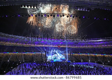 KYIV, UKRAINE - OCTOBER 8: Spectators watch fireworks at the end of opening ceremony of main Euro-2012 arena - Olympic stadium (NSC Olimpiysky) on October 8, 2011 in Kyiv, Ukraine