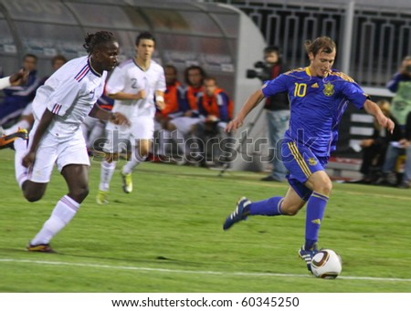KYIV, UKRAINE - SEP 3: Roman Zozulya (R) of Ukraine (Under-21) National Team controls a ball during UEFA European Under-21 Championship qualifying game against France on September 3, 2010 in Kyiv