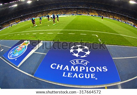 KYIV, UKRAINE - SEPTEMBER 16, 2015: Board with UEFA Champions League Logo on the grass before the game between FC Dynamo Kyiv and FC Porto at NSC Olimpiyskyi stadium - stock photo