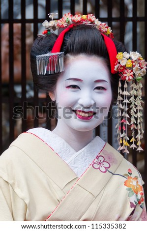 KYOTO - APRIL 10 2012: A Geisha in Gion district in Kyoto on April 10 2012. Geisha is traditional Japanese female entertainer. They can be spotted mostly in Gion district in Kyoto. - stock photo