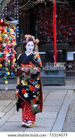 KYOTO - JAN 16: Unidentified geisha visiting a shinto temple on January 16, 2010 in Gion district, Kyoto, Japan. Geishas are skilled in traditional arts such as music, dance, singing and tea ceremony. - stock photo