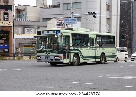 KYOTO, JAPAN - APRIL 15, 2012: Hino bus in Kyoto, Japan. Hino Motors exists since 1942, employs 9.500 people (2008) and is part of Toyota Motor Company.