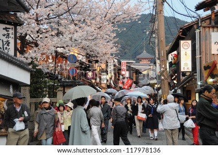 KYOTO, JAPAN - April 9 2012: Tourists walk on a street leading to Kiyomizu Temple on April 9 2012 for Sakura viewing. Kiyomizu is a famous temple in Kyoto founded in year 778.
