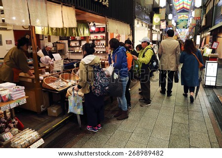 KYOTO, JAPAN -APRIL 13, 2015:  unidentified people walked along the famous Nishiki Market on April 13, 2015 in Kyoto Japan - stock photo